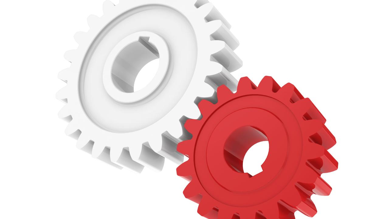 Red and white cog gears interlocked
