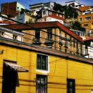 A view upwards towards a series of colorful homes in Valparaiso.
