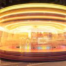 A time-lapse photo of a merry-go-round that makes it motion look like a whirling blur.