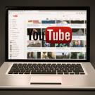 A YouTube channel page displayed on a laptop screen.